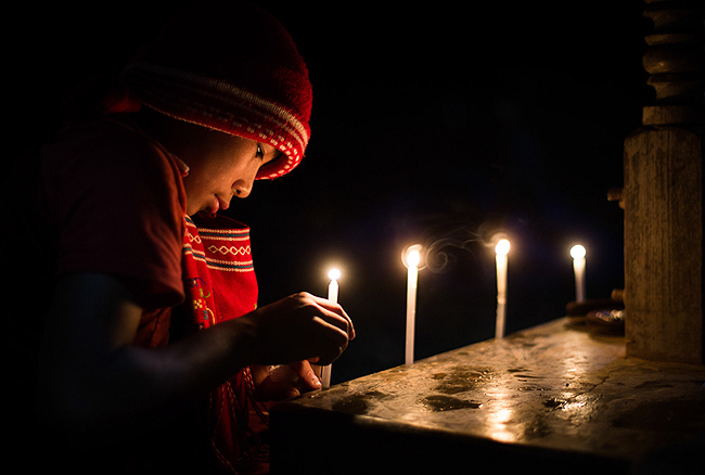 Boy lighting candles