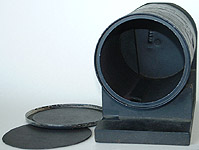 The curved interior of this round container permits you to evenly bend your photo-sensitive material (paper or film) against the inner wall that is on the opposite side to the pinhole, making for interesting pinhole image effects.
