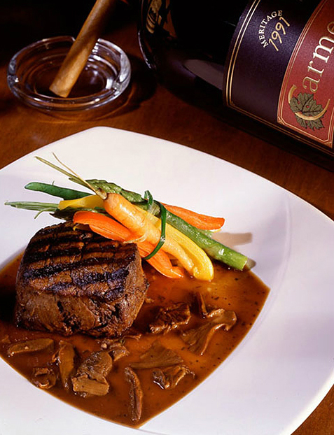 Filet in a mushroom sauce served with a bundle of garden vegetables.