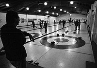 The silhouetted curler in the foreground leads the viewer's eye into the picture and provides a sense of dimension