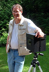 Daniel Bouman on the deck of his home with a favorite camera - an 8