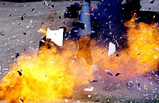 High shutter speed froze this explosion's debris in mid-air