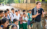 Etienne in discussion with a group of students while running a photo tour in Myanmar.