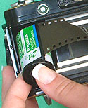 Be sure the film cartridge is properly positioned in the camera.