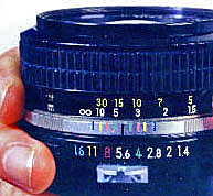 The bottom scale on this lens shows f-NUMBERS from ƒ/16 to ƒ/1.4.