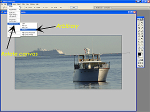 With the Measure tool's line directly on the horizon line, click on Image > Rotate Canvas > Arbitrary.