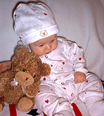 Mr. Jingles is the name of the lucky teddy bear leaning on photographer Nancy's baby girl.