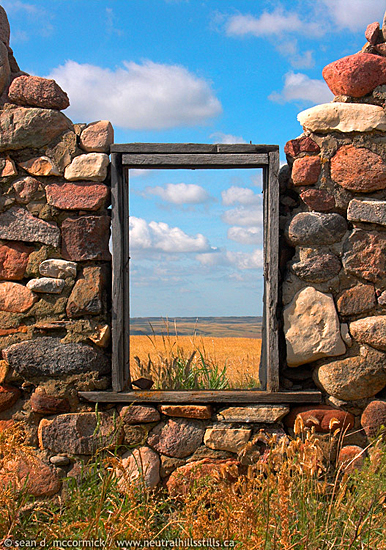 Like a painting on a wall, this prairie scene is perfectly framed in the ruins of an old building.