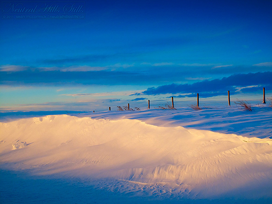 The early light of sunrise can often make the most mundane subject, like a snowbank, seem dramatic.