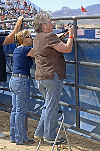 This rodeo photographer came prepared. She knew she had to get above the tarpaulin to photograph the event.