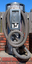 Our first picture is a close-up of the coiled hose of this vacuum cleaner.