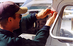The window of a Cessna is hinged along the top and can be opened fully by detaching its window retaining bar (which is done before take-off by simply removing a screw).