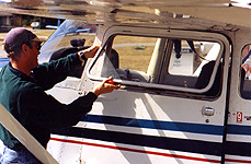Once the retaining bar is disconnected, the Cessna's window will open completely for an unrestricted view.