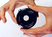 An adjustable DIAPHRAGM in a lens controls the size of the aperture.