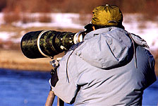 A TELEPHOTO LENS of this super size magnifies the scene like a telescope.