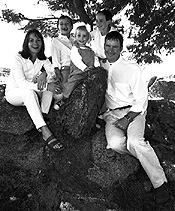 Same family taken on black and white film - posed differently, and in a new setting. The memories have been captured in spite of the differences. Don't be afraid to try different approaches for family pictures.