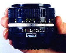 The bottom row of numbers (16, 11, 8, etc.) on this lens shows the aperture settings of the lens, which is currently set at -5.6. The numbers are inscribed on an adjustable
