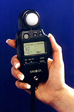 This handheld EXPOSURE METER measures both incident light and electronic flash.