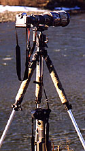 Stability can be increased by suspending a heavy item from the center column of a tripod.