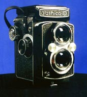 The twin-lens reflex camera shares the viewfinder cameras problem of PARALLAX ERROR because the lens you look through is not the lens that takes the picture.